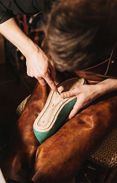 person repairing a shoe