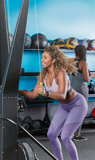 A woman using gym equipment