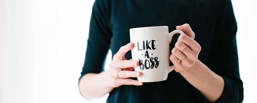 Woman with a like a boss mug