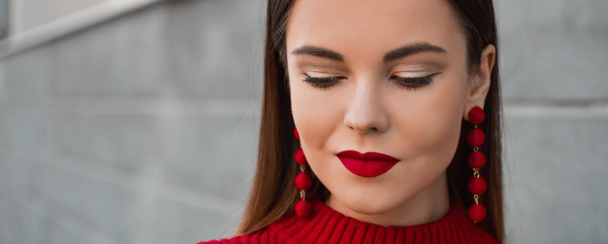 woman with red lipstick and red jumper